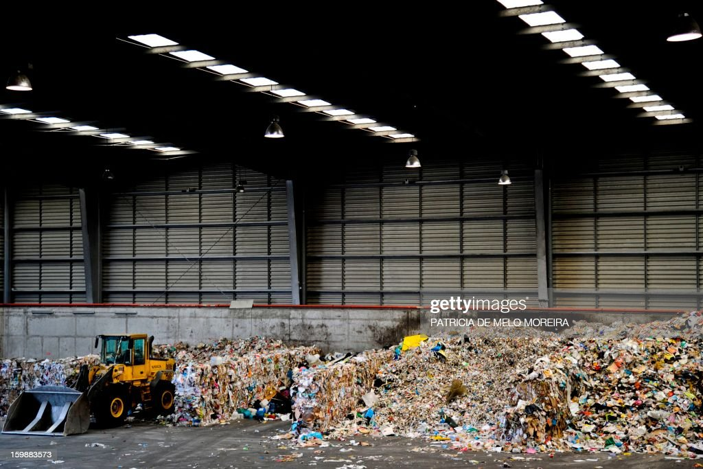 A picture taken on January 22, 2013 shows piles of garbage for recycling at Valorsul, a waste treatment plant, in Lisbon.