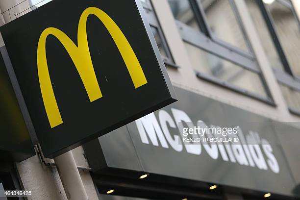 A picture taken on January 22 2014 in Paris shows the logo of a US fast food restaurant Mac Donald's Vicepresident for finance of McDonald's France...
