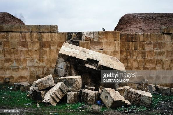 TOPSHOT A picture taken on January 22 2017 shows damaged walls of the Nineveh ruins in eastern Mosul after it was destroyed by the Islamic State...