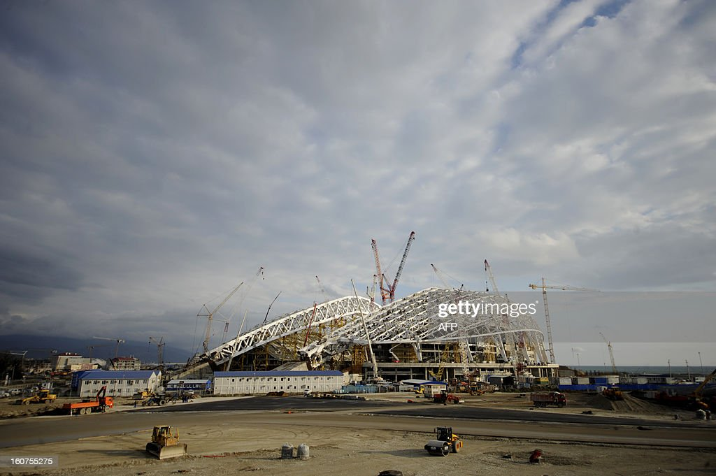 A picture taken on January 22, 2013, shows a general view of the construction site of 'Fisht' Olympic Stadium in the Imereti Valley in the Russian Black Sea resort of Sochi. One year before Russia kicks off the 22nd Winter Olympic Games on February 7, 2014, its host city Sochi is one of the world's biggest construction sites, with works proceeding on schedule but declared a disaster by environmentalists. AFP PHOTO / MIKHAIL MORDASOV