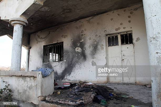 A picture taken on January 23 2013 in the southern Syrian city of Sweida shows the damage inflicted upon a house from the ongoing conflict The two...