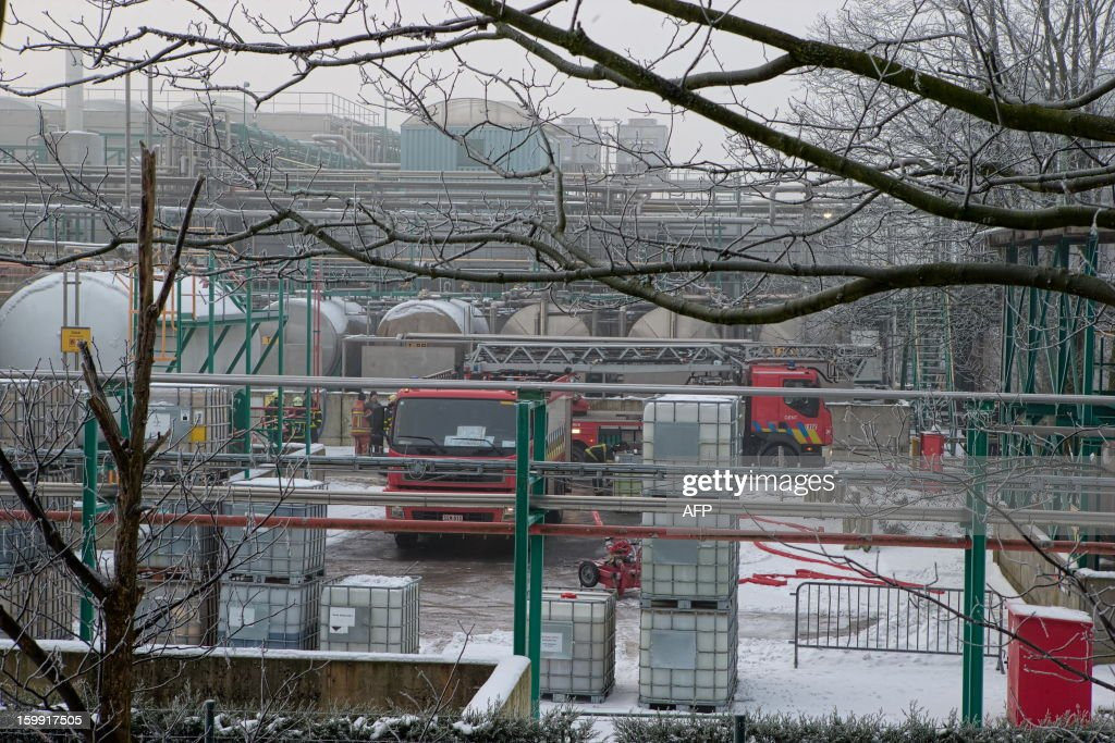 A picture taken on January 23, 2013 shows firemen working after an explosion, followed by a fire, at the Buckman Laboratories, earlier today in Gent. The Seveso ranked plant manufacturing specialty chemicals for water treatment, pulp and paper, and leather industries, was evacuated and a 900-meter security perimeter was set. One worker was burnt and brought to hospital.