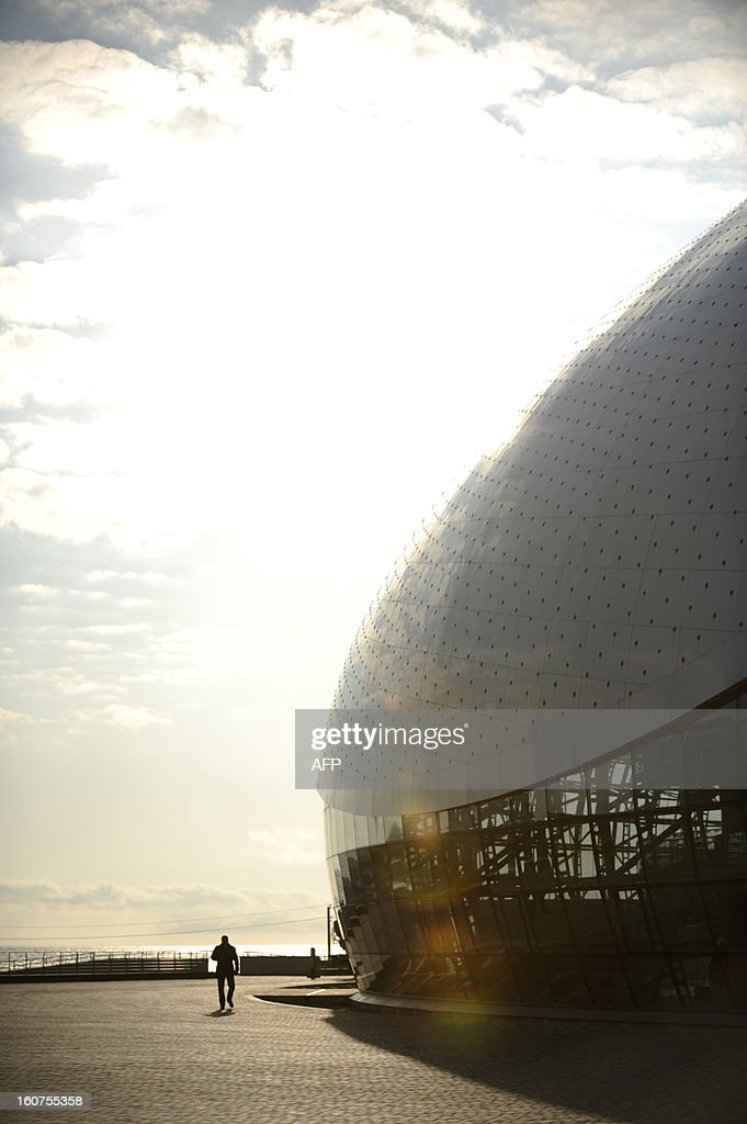 A picture taken on January 23, 2013, shows a general view of the Bolshoi Ice Palace construction site in the Russian Black Sea resort of Sochi. One year before Russia kicks off the 22nd Winter Olympic Games on February 7, 2014, its host city Sochi is one of the world's biggest construction sites, with works proceeding on schedule but declared a disaster by environmentalists. AFP PHOTO / MIKHAIL MORDASOV