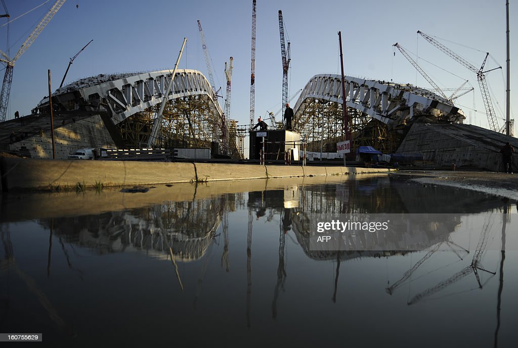 A picture taken on January 23, 2013, shows a view of the construction site of 'Fisht' Olympic Stadium in the Imereti Valley in the Russian Black Sea resort of Sochi. One year before Russia kicks off the 22nd Winter Olympic Games on February 7, 2014, its host city Sochi is one of the world's biggest construction sites, with works proceeding on schedule but declared a disaster by environmentalists. AFP PHOTO / MIKHAIL MORDASOV