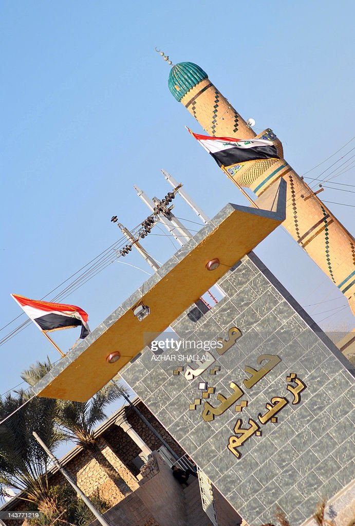 A picture taken on January 24, 2012 shows a sign which reads in Arabic 'Welcome to Haditha' at the entrance of the town in the western Iraq Anbar province, where 24 Iraqis were killed by US troops in 2005. Residents of the town of around 80,000 people, including relatives of those killed by US troops in 2005, have voiced shock and disgust over the light sentence meted out to a US soldier involved in the massacre.