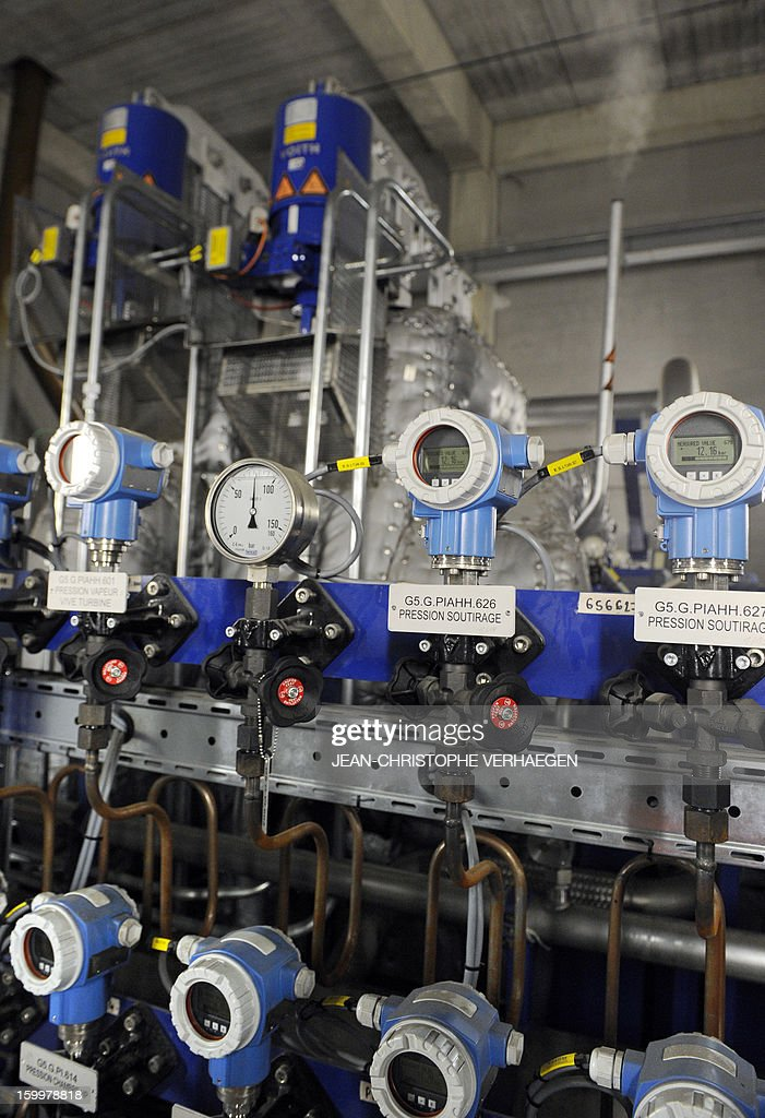 A picture taken on January 24, 2013 shows a group turbo alternator producing electricity at the UEM ('Usine d'Electricité de Metz' in French) biomass plant in Metz, eastern France. This thermal power plant, coal-fired, gas and biomass, provides electricity and heat to Metz and to the surrounding towns.