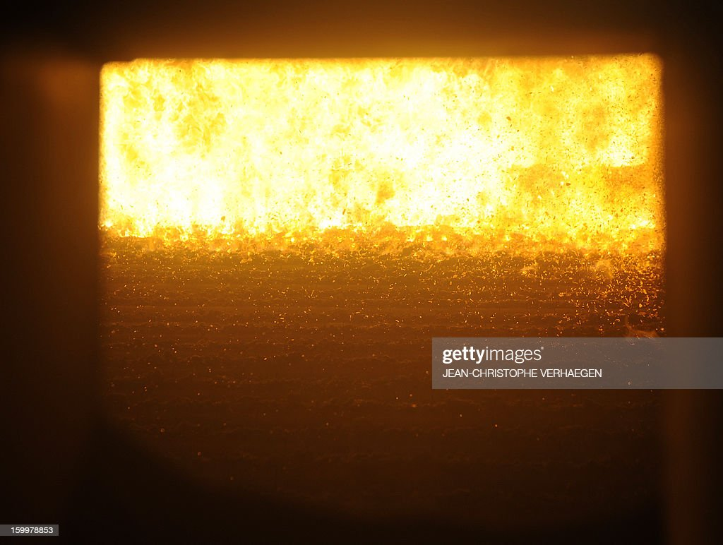 A picture taken on January 24, 2013 shows the boiler at the UEM (Usine d'Electricité de Metz) biomass plant in Metz, eastern France, on January 24, 2013. This thermal power plant, coal-fired, gas and biomass, provides electricity and heat to Metz and to the surrounding towns. AFP PHOTO / JEAN-CHRISTOPHE VERHAEGEN