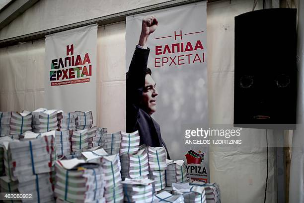 A picture taken on January 24 2015 shows a Syriza party's poster reading ''the hope is coming'' in an election campaign kiosk in Athens The leader of...