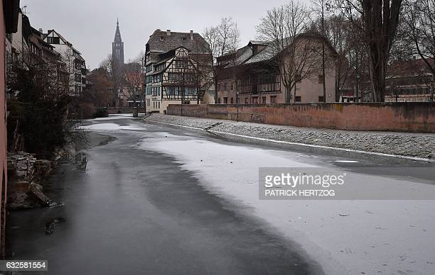 A picture taken on January 24 2017 shows a frozen river the Ill in the 'Petite France' district in central Strasbourg eastern France A toxic cocktail...