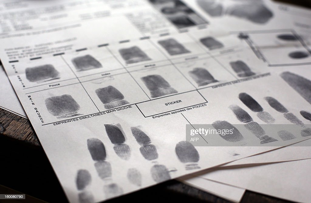 A picture taken on January 25, 2013 at the forensic unit of Poissy's police headquarters (Police Technique et Scientifique (PTS) unit, on January 25, 2013 at Poissy, west of Paris. shows a copy of fingerprints. AFP PHOTO THOMAS SAMSON