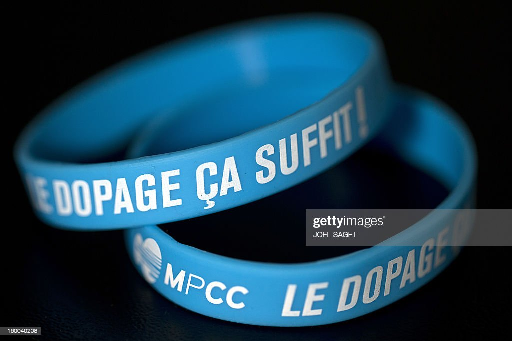 A picture taken on January 25, 2013 in Paris shows bracelets of the MPCC (Mouvement pour un cyclisme credible) to be wear to fight against doping in cycling. AFP PHOTO /JOEL SAGET