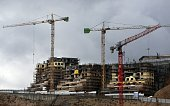 A picture taken on January 27 2016 shows cranes at a construction site in the Israeli settlement of Ramot built in a suburb of mostly Arab east...