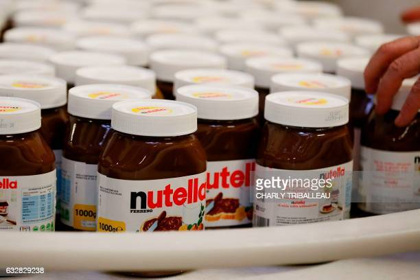 A picture taken on January 27 2017 in the Ferrero plant in VillersEcalles northwestern France shows Nutella pots The Ferrero plant of VillersEcalles...