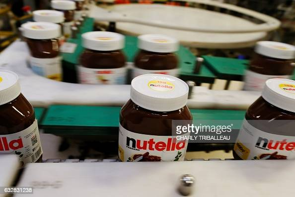 A picture taken on January 27 2017 in the Ferrero plant in VillersEcalles northwestern France shows Nutella jars The Ferrero plant of VillersEcalles...