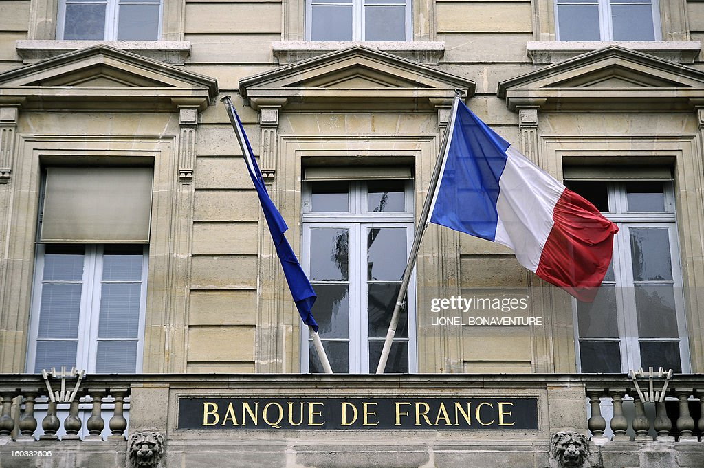 A picture taken on January 29, 2013 shows French flags on the fronton of Bank of France (Banque de France) building in Paris.