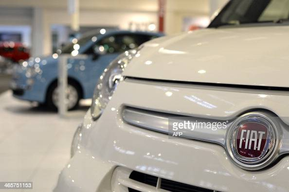 A picture taken on January 29 2014 in Rome shows the logo of Fiat on a Fiat 500 Italian car giant Fiat announced today it was changing its name after...