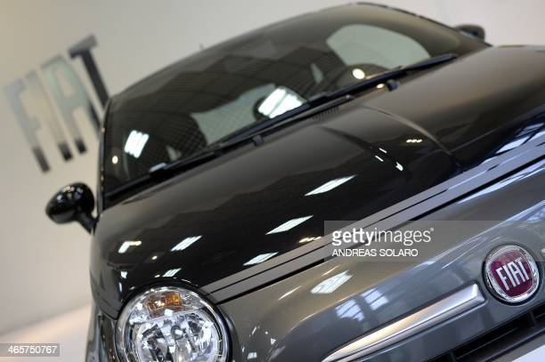 A picture taken on January 29 2014 shows a Fiat 500 in a car dealer in Rome Italian car giant Fiat announced today it was changing its name after...