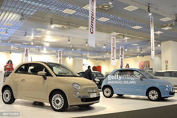 A picture taken on January 29 2014 shows Fiat 500 in a car dealer in Rome Italian car giant Fiat announced today it was changing its name after...