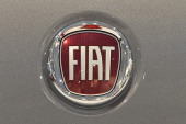 A picture taken on January 29 2014 shows the logo of Fiat in a car dealer in Rome Italian car giant Fiat announced today it was changing its name...