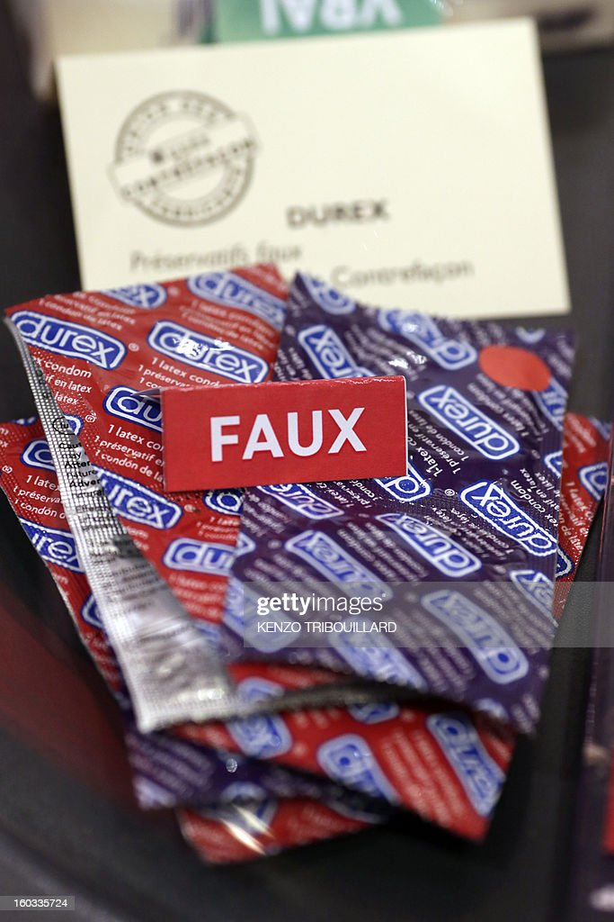 A picture taken on January 29, 2013, shows fake Durex condoms on display during the inauguration of the exhibition 'Contrefaçon, sans façon', held until March 8 at the CCI France in Paris. AFP PHOTO / KENZO TRIBOUILLARD