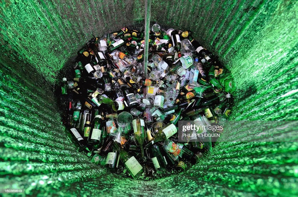A picture taken on January 30, 2013 shows broken glass in a recycle bin in Godewaersvelde. AFP PHOTO PHILIPPE HUGUEN