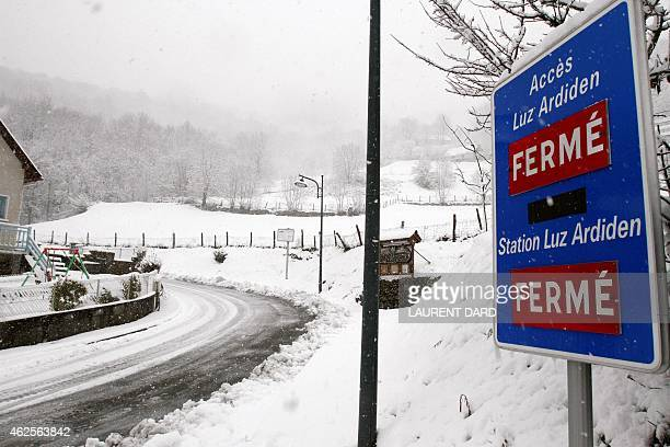 A picture taken on January 30 2015 shows a sign announcing the closure of the access to Luz Ardiden station during snowfall in LuzSaintSauveur The...
