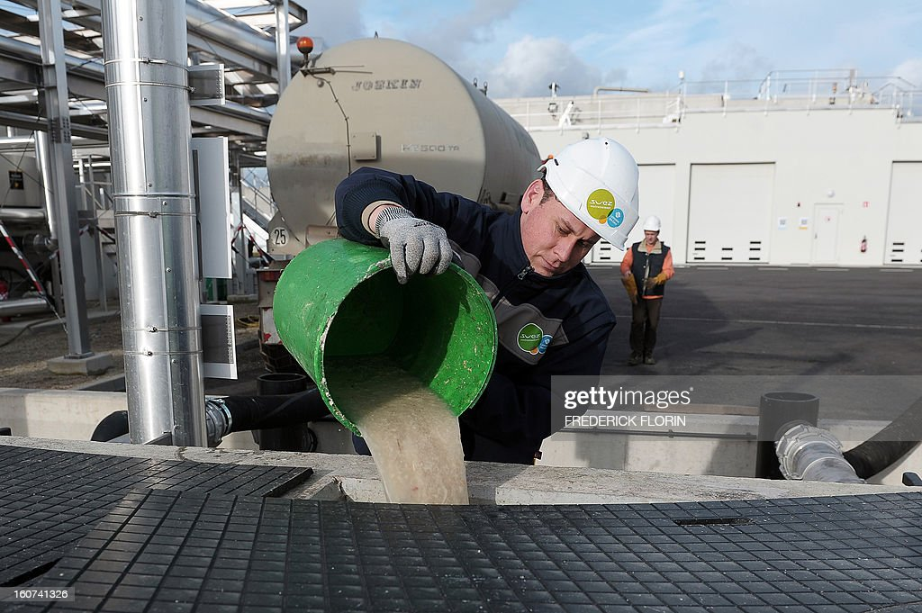 A picture taken on January 31, 2013 in Meistratzheim, near in Krautergersheim, eastern France, shows a technician working on sauerkraut juice at a new waste-water treatment plant. In Krautergersheim, the self-proclaimed sauerkraut capital, polluting sauerkraut juice obtained after fermenting cabbage, is transformed into heat and electricity at a waste-water treatment plant through anaerobic digestion, a bacterial process that produces methane, which can be used in generators for electricity production and/or in boilers for heating purposes. AFP PHOTO / FREDERICK FLORIN