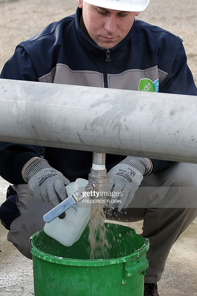 A picture taken on January 31, 2013 in Meistratzheim, near in Krautergersheim, eastern France, shows a technician sampling sauerkraut juice at a new waste-water treatment plant. In Krautergersheim, the self-proclaimed sauerkraut capital, polluting sauerkraut juice obtained after fermenting cabbage, is transformed into heat and electricity at a waste-water treatment plant through anaerobic digestion, a bacterial process that produces methane, which can be used in generators for electricity production and/or in boilers for heating purposes.