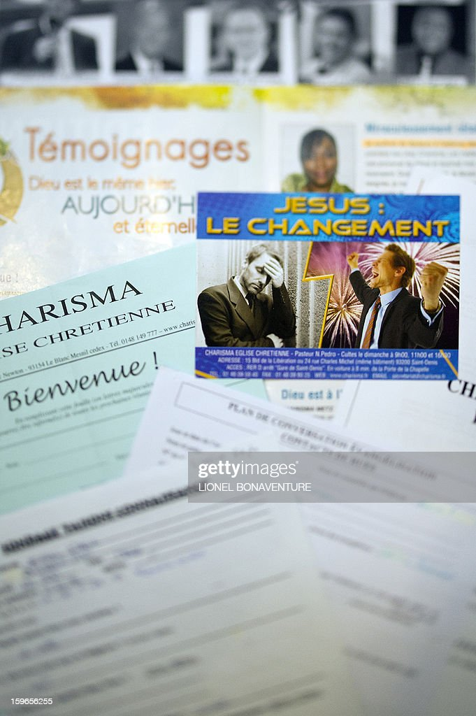 A picture taken on January 4, 2013 in Paris shows leaflets of the Charisma church. AFP PHOTO / LIONEL BONAVENTURE