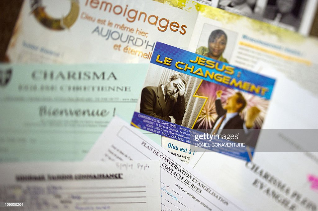 A picture taken on January 4, 2013 in Paris shows leaflets of the Charisma church.