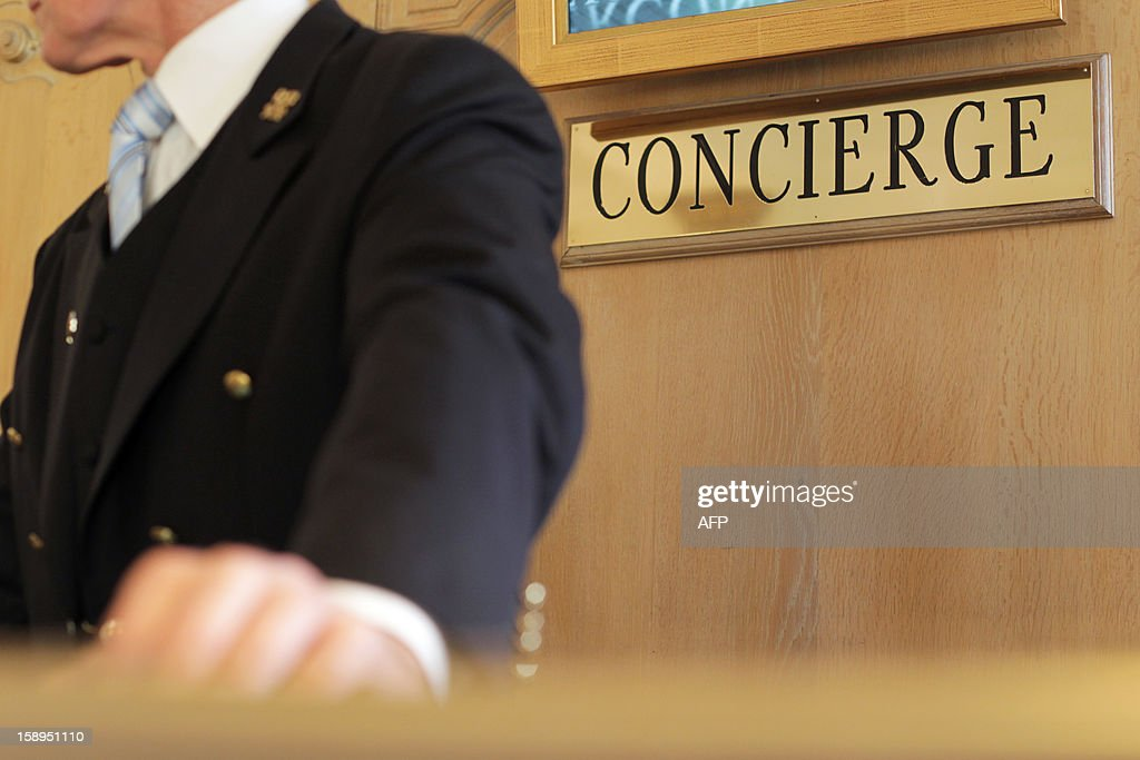 A picture taken on January 4, 2013 shows a concierge of a luxury hotel in Cannes, southeastern France. AFP PHOTO / JEAN CHRISTOPHE MAGNENET