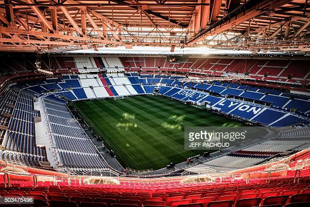 A picture taken on January 5 2016 shows the tribunes and pitch inside Olympique Lyonnais football club's new stadium the Stade des Lumieres aka Grand...