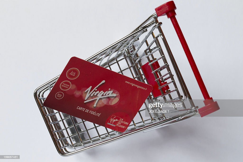 Picture taken on January 7, 2013 in Paris shows an illustration made with a Virgin Megastore loyalty card in a miniature toy shopping cart. The Virgin Megastore chain, which currently employs 1000 workers in France, is planning to file for bankruptcy and is convening an extraordinary board meeting to this effect on January 7. AFP PHOTO/JOEL SAGET