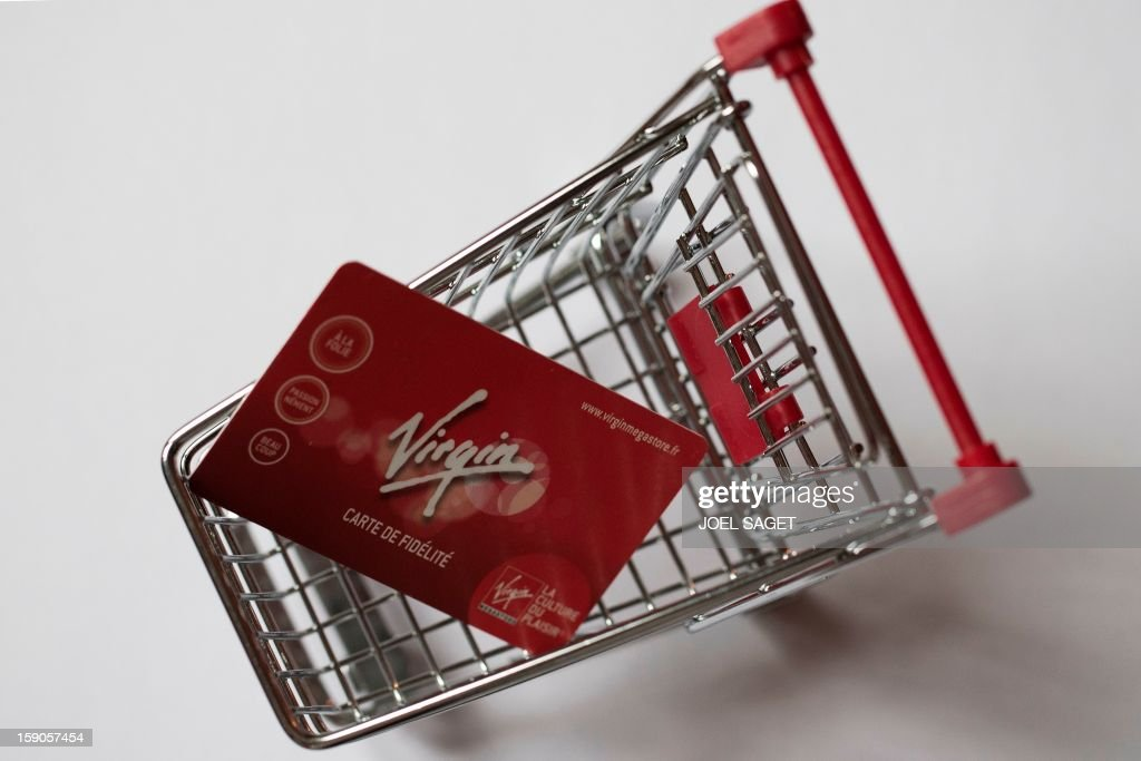 Picture taken on January 7, 2013 in Paris shows an illustration made with a Virgin Megastore loyalty card in a miniature toy shopping cart. The Virgin Megastore chain, which currently employs 1000 workers in France, is planning to file for bankruptcy and is convening an extraordinary board meeting to this effect on January 7.