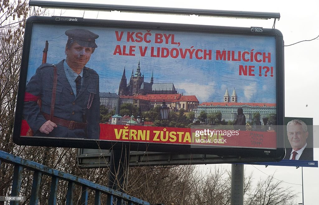 A picture taken on January 7, 2013 in Prague shows a billboard featuring former Czech former Prime Minister and presidential candidate Jan Fischer in the uniform of the People's Militias ( militia organisation of Communist Party in former Czechoslovakia) warning Czech voters for former Fischer's membership in Communists party. Text reads '' He was in Communists party, but no in the People's Militias?''. Billboard of Milos Zeman, other presidential candidate is seen in background. The first Czech direct presidential election will be held on January 11-12, 2013.
