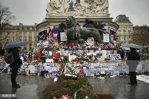 TOPSHOT A picture taken on January 7 2016 shows a makeshift memorial for the victims of Paris attacks at the Place de la Republique in Paris as...