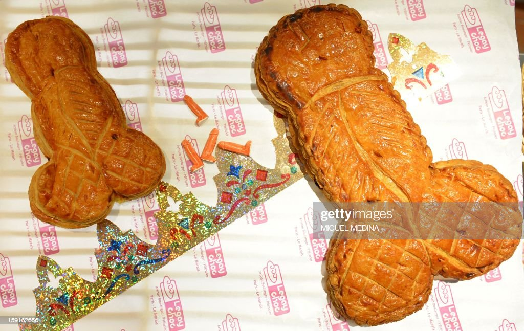 A picture taken on January 9, 2013 shows penis-shaped Ephiphany cakes (galette des rois) and penis-shaped trinkets in the Marais district of Paris.