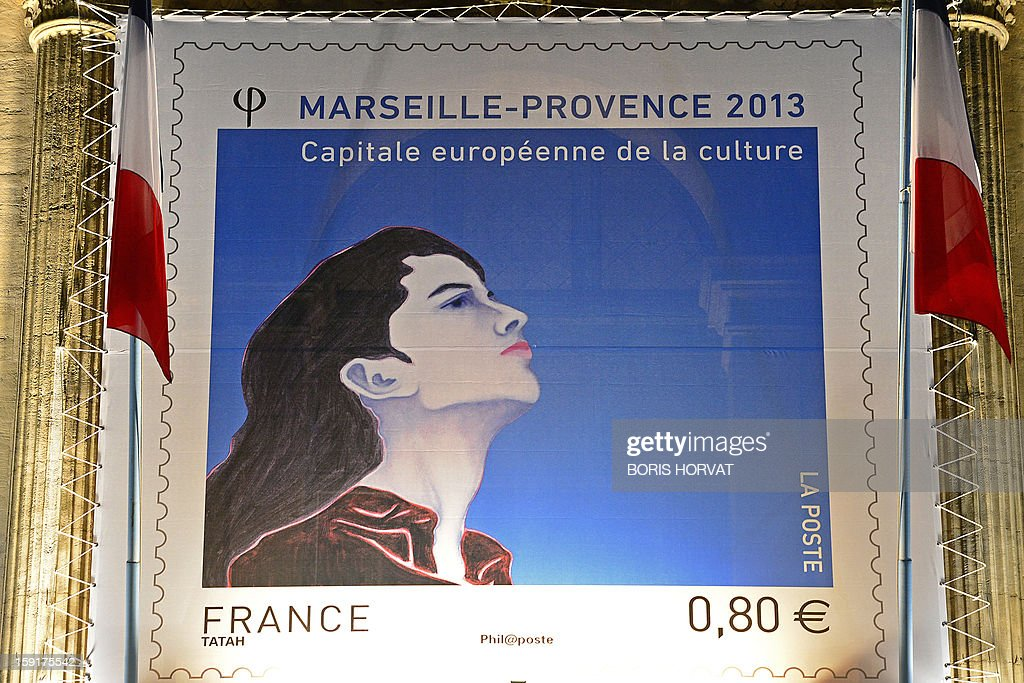 A picture taken on January 9, 2013 shows the effigy of a new stamp published by French postal services La Poste, displayed on the facade of the regional prefecture in Marseille, southern France, ahead of the 2013 'Marseille-Provence European Capital of Culture', starting on January 12. The effigy represents the face of the European Capital of Culture. AFP PHOTO / BORIS HORVAT