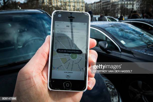 A picture taken on January 9 2016 in Paris shows a smartphone displaying the app for ride service Uber with a box reading 'No more drivers' as Uber...
