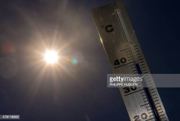 A picture taken on July 1 2015 shows a thermometer in Lille as a major heatwave spreads up through Europe with temperatures hitting nearly 40 degrees...