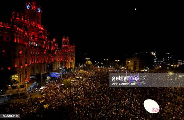 A picture taken on July 1 2017 shows the Cibeles Palace Madrid's City Hall with revellers celebrating at Cibeles square during the WorldPride 2017...