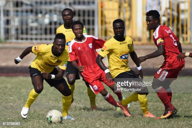 A picture taken on July 12 2017 shows Kumasi Asante Kotoko Football Club's players vying for the ball with players of Inter Allies Football Club...