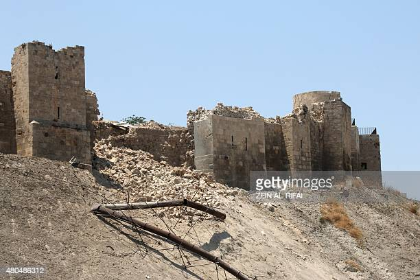 A picture taken on July 12 shows a damaged wall of Aleppo Citadel following a reported explosion the previous night in a tunnel near the monumental...