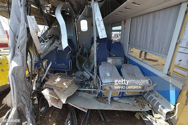 A picture taken on July 13 2016 shows remains of the train crash site near Corato in the southern Italian region of Puglia as rescuers searched for...