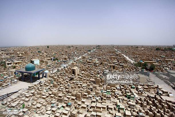 A picture taken on July 14 2014 shows graves stretching away into the horizon at one of the world's biggest cemeteries in the Iraqi holy Shiite city...