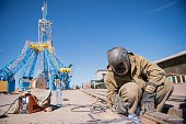 A picture taken on July 14 2015 shows a worker at the construction site of the Vostochny cosmodrome in Russia's Far Eastern Amur region AFP PHOTO /...
