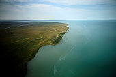 A picture taken on July 14 2016 shows an aerial view of the Balkhash lake in Kazakhstan The Balkhash lake is one of the largest lakes in Asia and the...