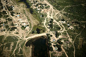 A picture taken on July 14 2016 shows an aerial view of the village sitting near the Balkhash lake in Kazakhstan The Balkhash lake is one of the...
