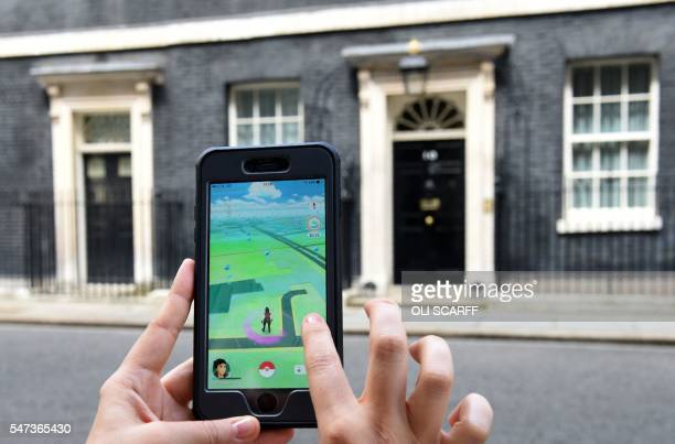 A picture taken on July 14 2016 shows an avatar on the screen of a mobile phone as a player uses the Pokemon Go application on their mobile phone as...
