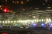 A picture taken on July 14 2016 shows an helicopter flying near the site of an attack in the French Riviera town of Nice after a truck that ploughed...